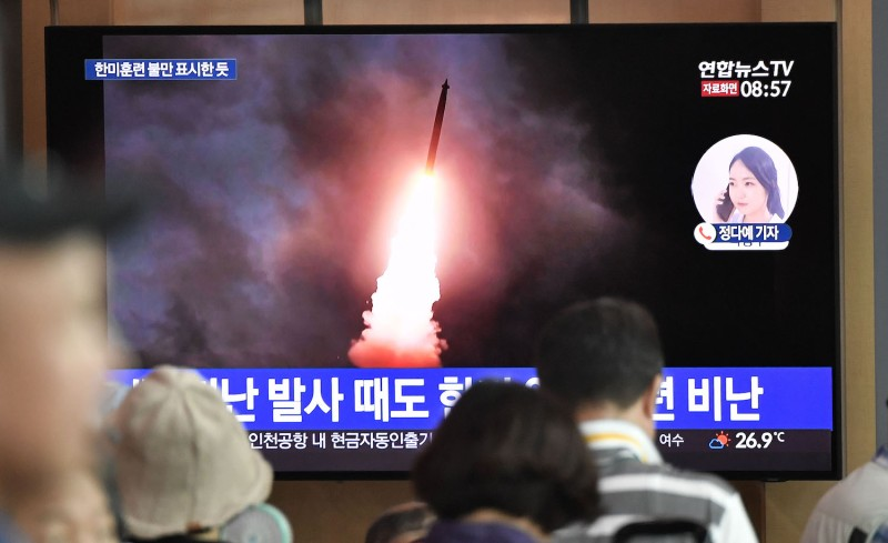 People watch a television news screen showing file footage of North Korea's missile launch, at a railway station in Seoul on August 10, 2019. (JUNG YEON-JE/AFP/Getty Images)