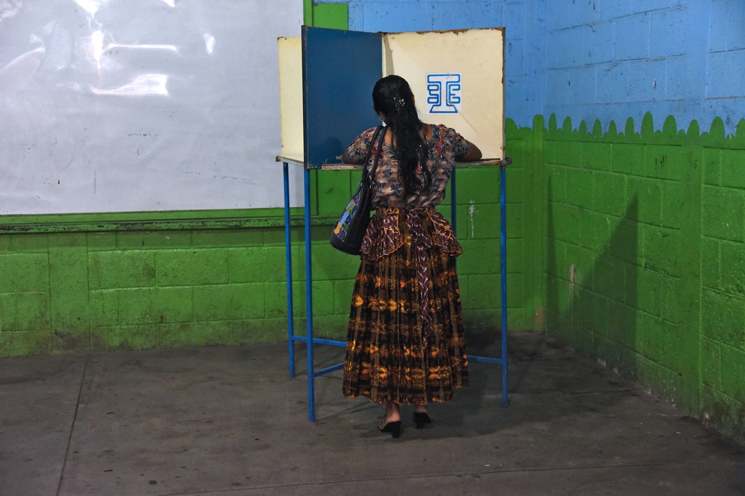 An indigenous woman votes during runoff elections in Santa Cruz Chinautla, Guatemala, on Aug. 11. ORLANDO ESTRADA/AFP/Getty Images