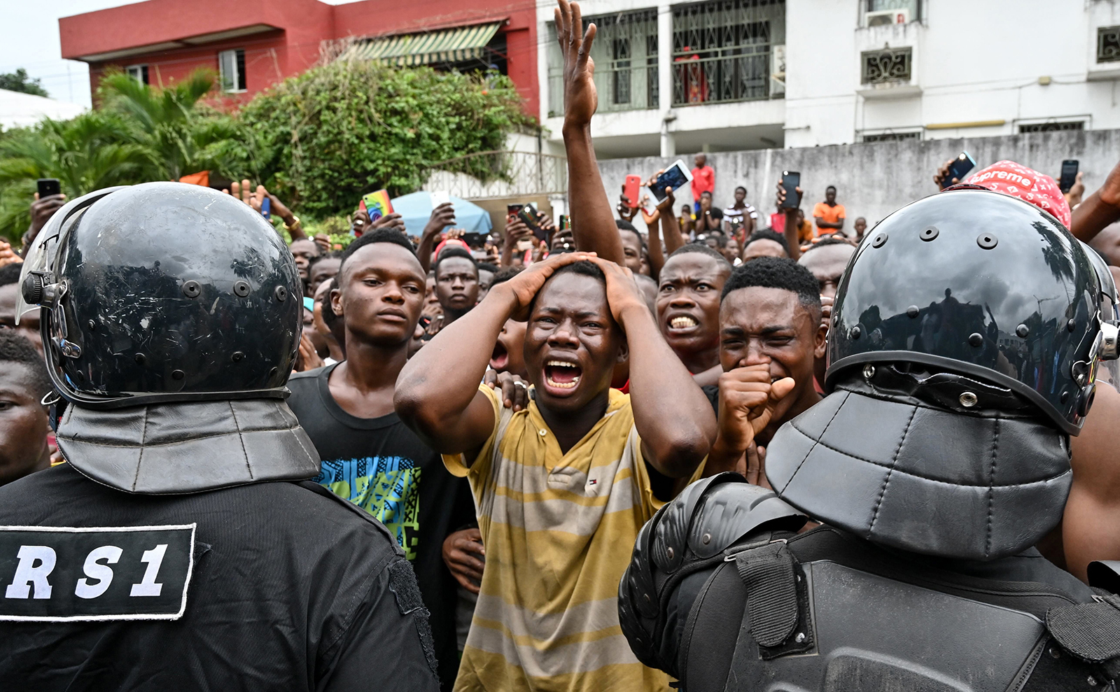 Fans cry outside an hospital in Abidjan after Ivorian singer DJ Arafat, one of the Ivory Coast's most popular artists, died at the age of 33 following a motorcycle accident on Aug. 12. ISSOUF SANOGO/AFP/Getty Images