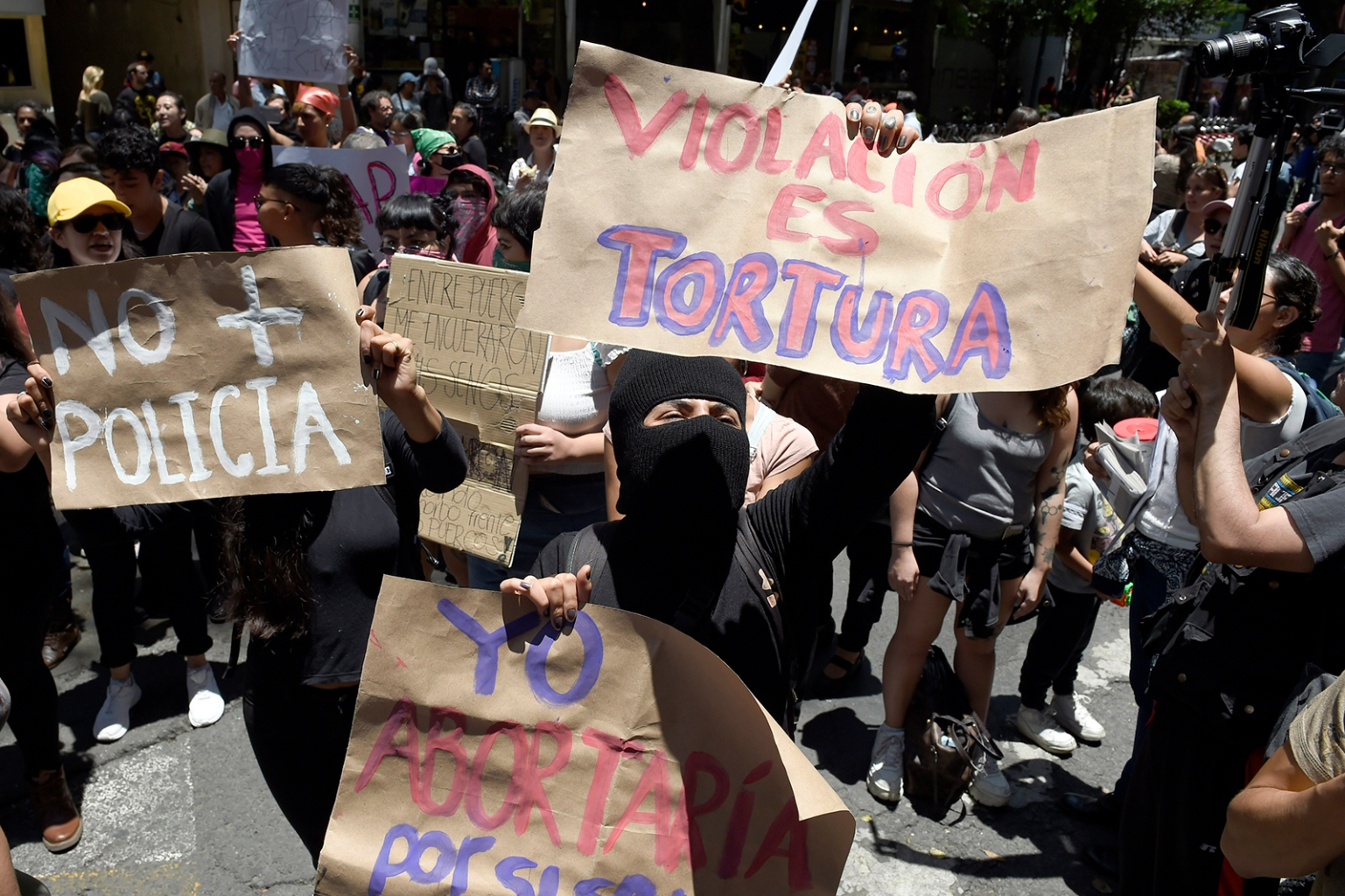 A group of activists take part in a protest called by civil organizations against the police, after four police officers were accused of raping a minor in their patrol car, in Mexico City on Aug. 12. ALFREDO ESTRELLA/AFP/Getty Images