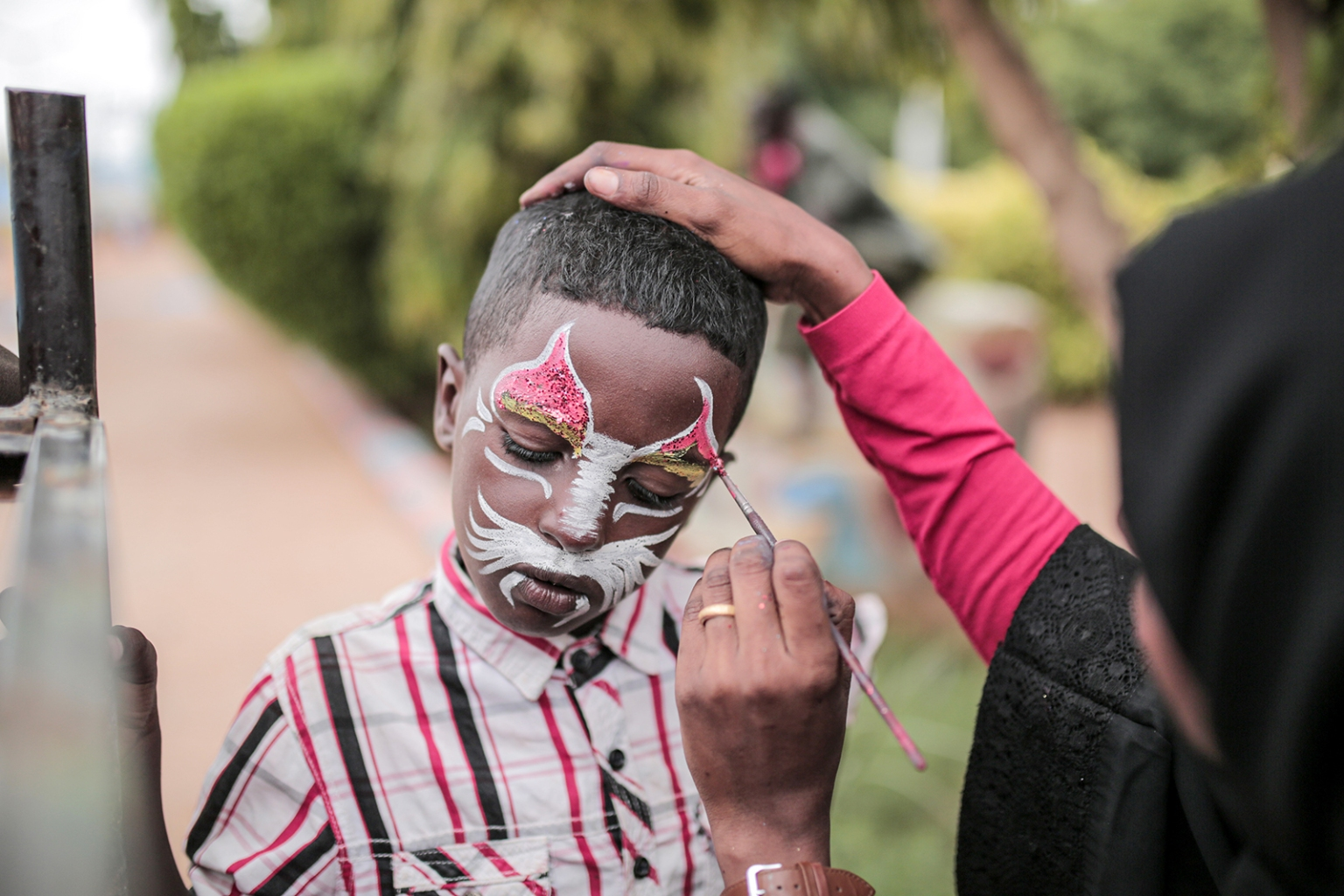 A Sudanese child has his face painted at an amusement park in Omdurman on Aug. 13. JEAN MARC MOJON/AFP/Getty Images