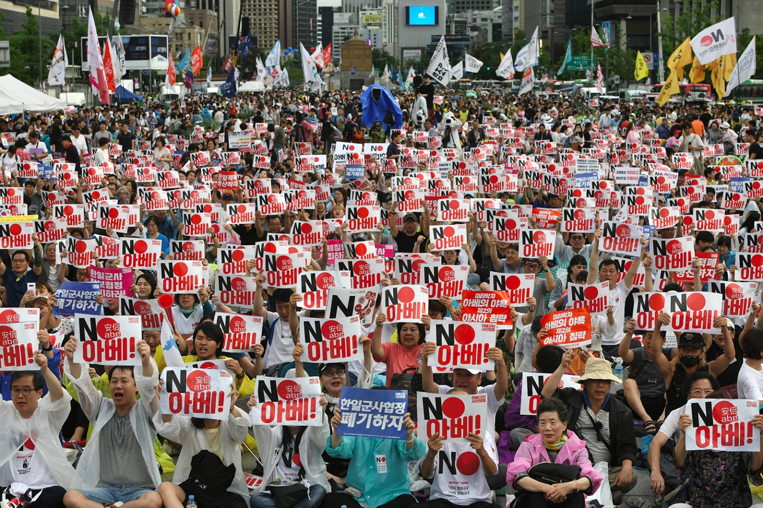 "South Korean protesters hold signs reading ""No Abe!"" during an anti-Japanese rally marking the anniversary of Korea's liberation from Japan's 1910-'45 colonial rule, in central Seoul on Aug. 15. JUNG YEON-JE/AFP/Getty Images"
