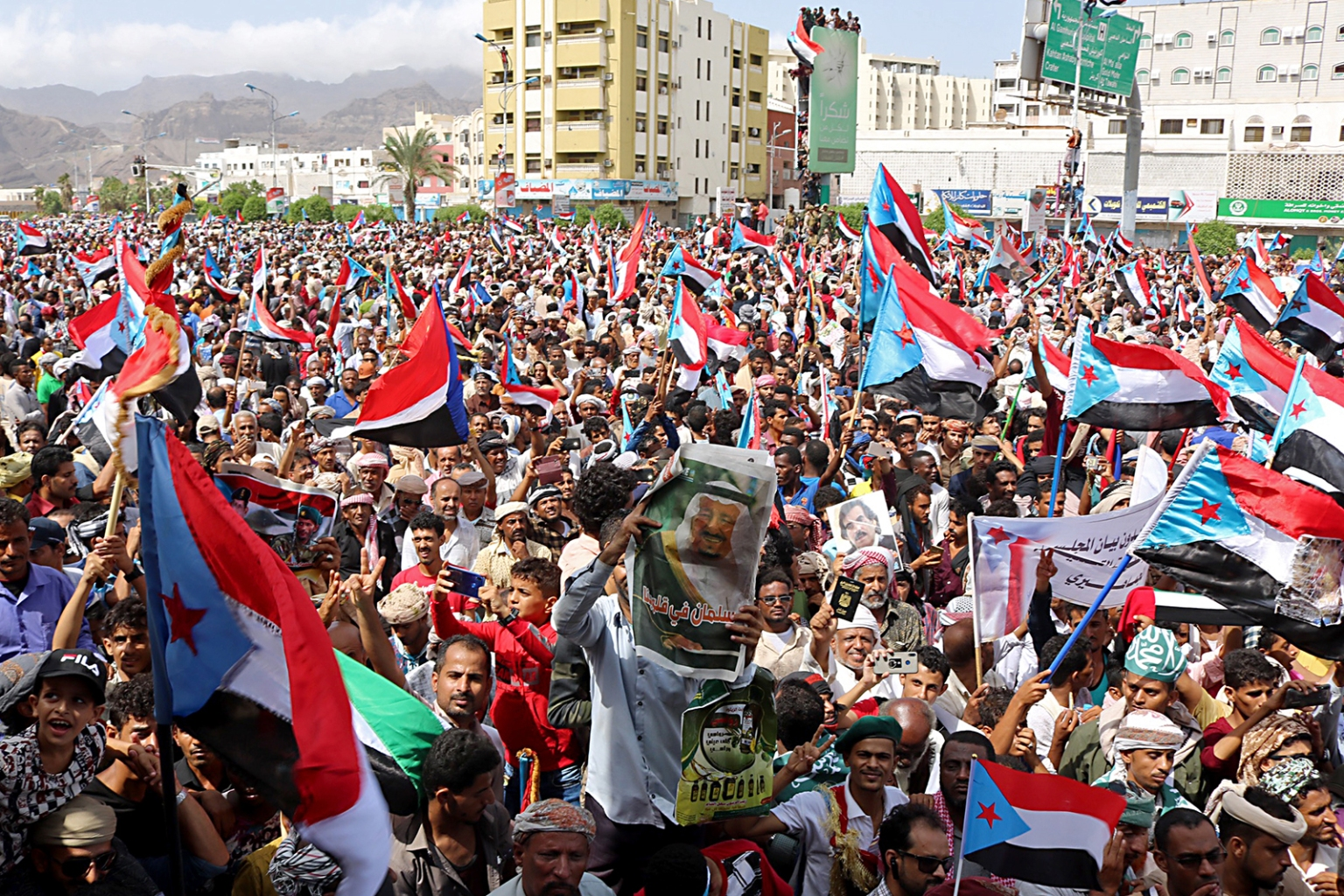 Supporters of Yemeni Southern separatists wave flags of the former South Yemen (The People's Democratic Republic of Yemen) as they demonstrate in the Khormaksar district of Aden on Aug. 15. Yemen's government ruled out talks with the separatists until they withdraw from positions seized last week in Aden. NABIL HASAN/AFP/Getty Images