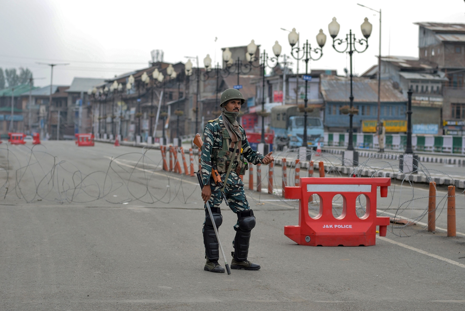 Security personnel stands guard along a street during a lockdown in Srinagar, Kashmir, on Aug. 15. SAJJAD  HUSSAIN/AFP/Getty Images