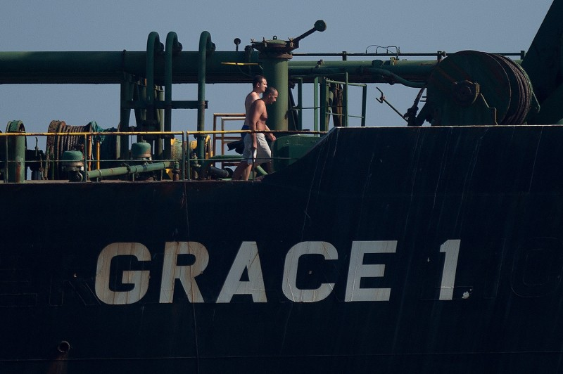 Crew members of Iranian supertanker Grace 1 walk on board off the coast of Gibraltar on August 15.