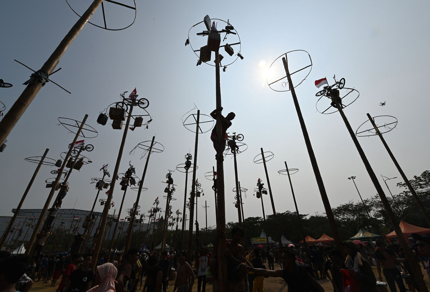 Participants climb greasy poles in Jakarta on Aug. 17, during Panjat Pinang, a pole-climbing contest to celebrate Indonesia's 74th anniversary of independence from Dutch rule. GOH CHAI HIN/AFP/Getty Images