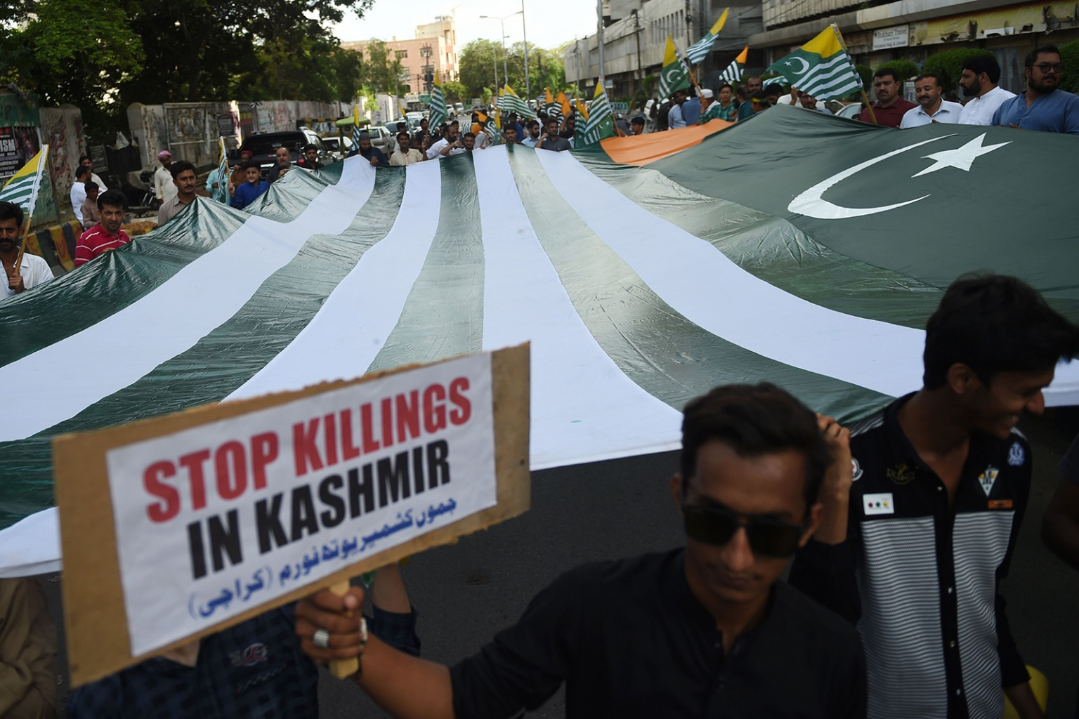 Demonstrators hold a giant flag of Pakistan-administered Kashmir during an anti-Indian protest in Karachi on Aug. 18. RIZWAN TABASSUM/AFP/Getty Images