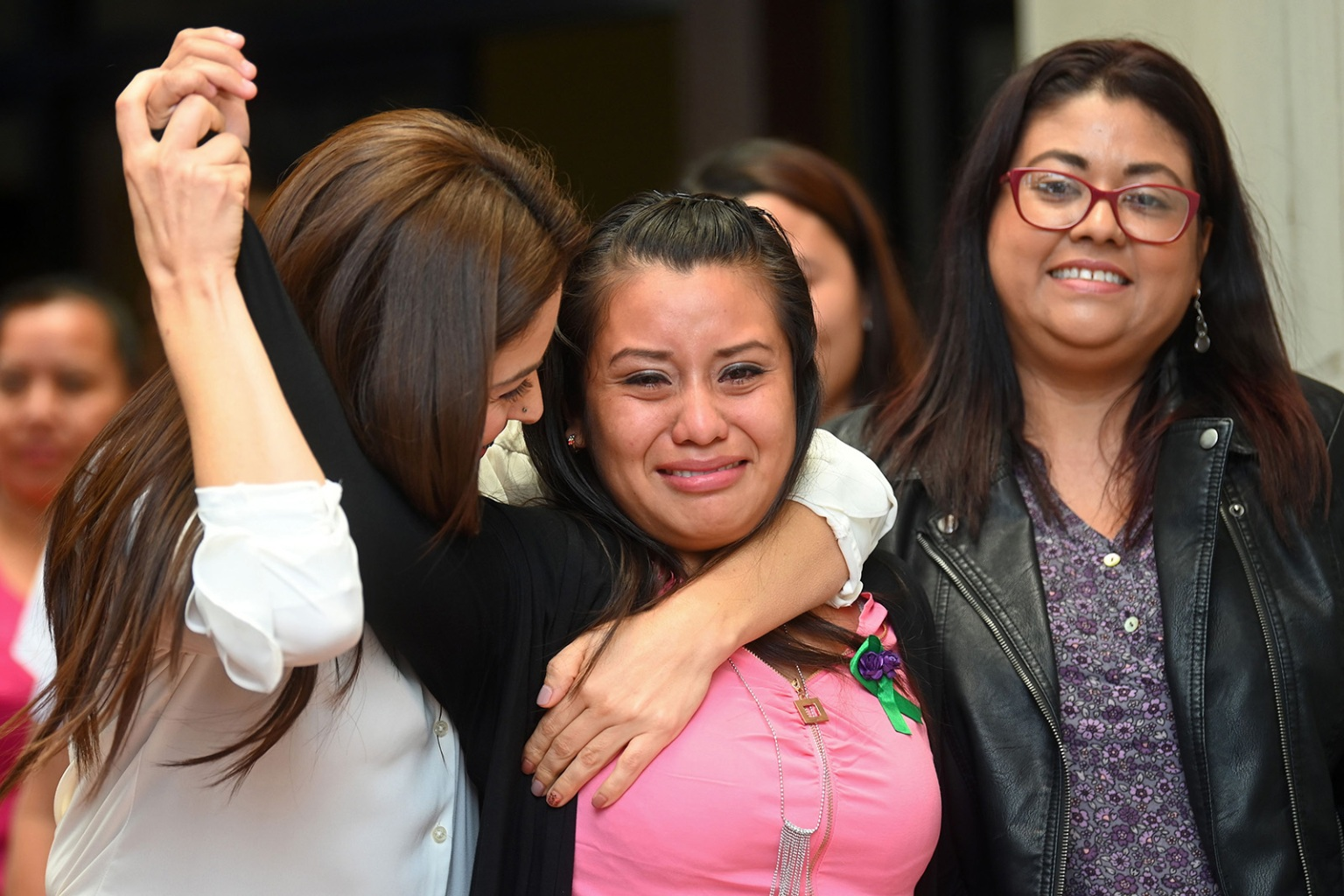 Salvadorean rape victim Evelyn Hernandez celebrates with her lawyers after being cleared of murder in San Salvador on Aug. 19. Hernandez gave birth to a stillborn baby at home in 2016 and was accused of murder in El Salvador, which has has an extremely strict ban on abortion. OSCAR RIVERA/AFP/Getty Images