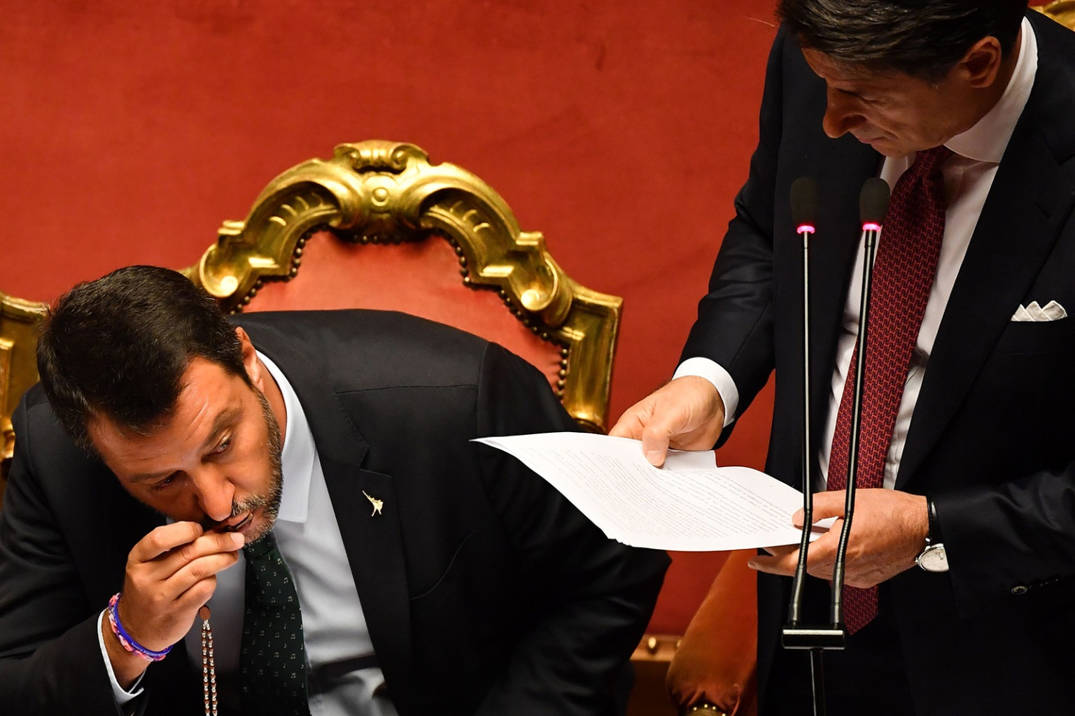 Deputy Prime Minister and Interior Minister Matteo Salvini kisses a rosary as Italian Prime Minister Giuseppe Conte delivers a speech offering his resignation at the Italian Senate in Rome on Aug. 20. ANDREAS SOLARO/AFP/Getty Images