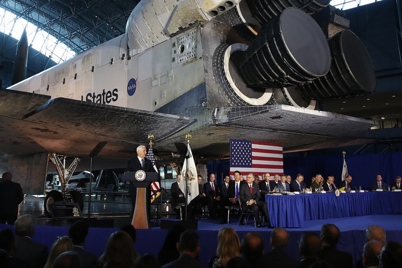 The Space Shuttle Discovery is the backdrop as U.S. Vice President Mike Pence speaks during a meeting of the National Space Council at the National Air and Space Museum's, Steven F. Udvar-Hazy Center, in Chantilly, Virginia, on Aug. 20.
