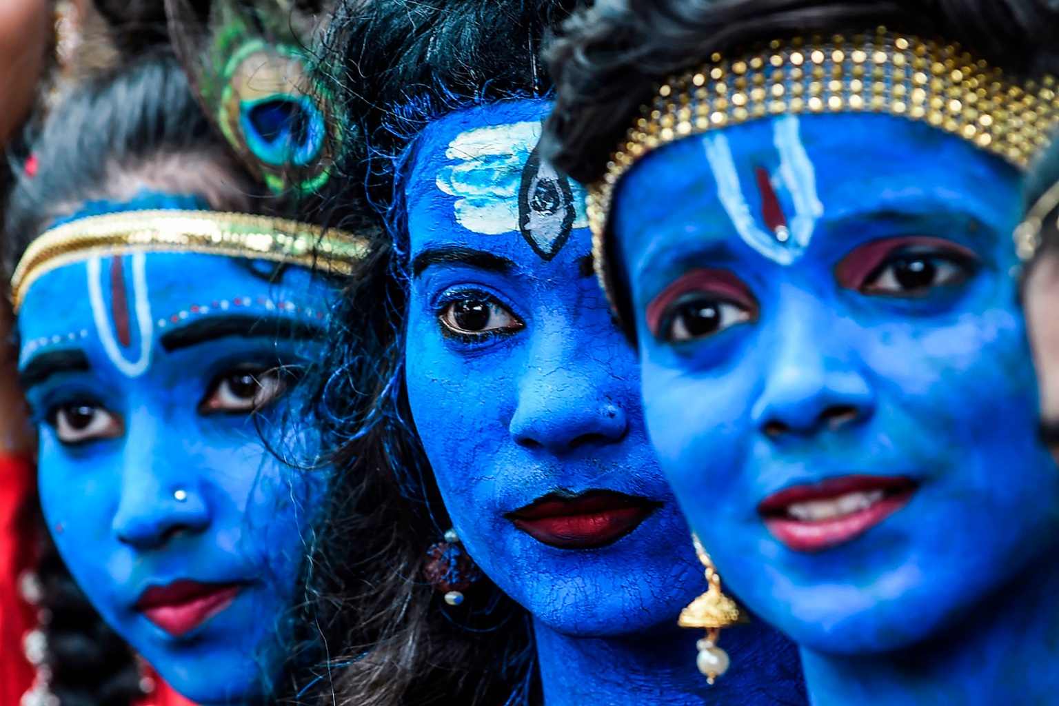 Students dressed as Hindu gods Lord Krishna and Lord Shiva participate in a cultural event at their school in Mumbai on Aug. 21. INDRANIL MUKHERJEE/AFP/Getty Images