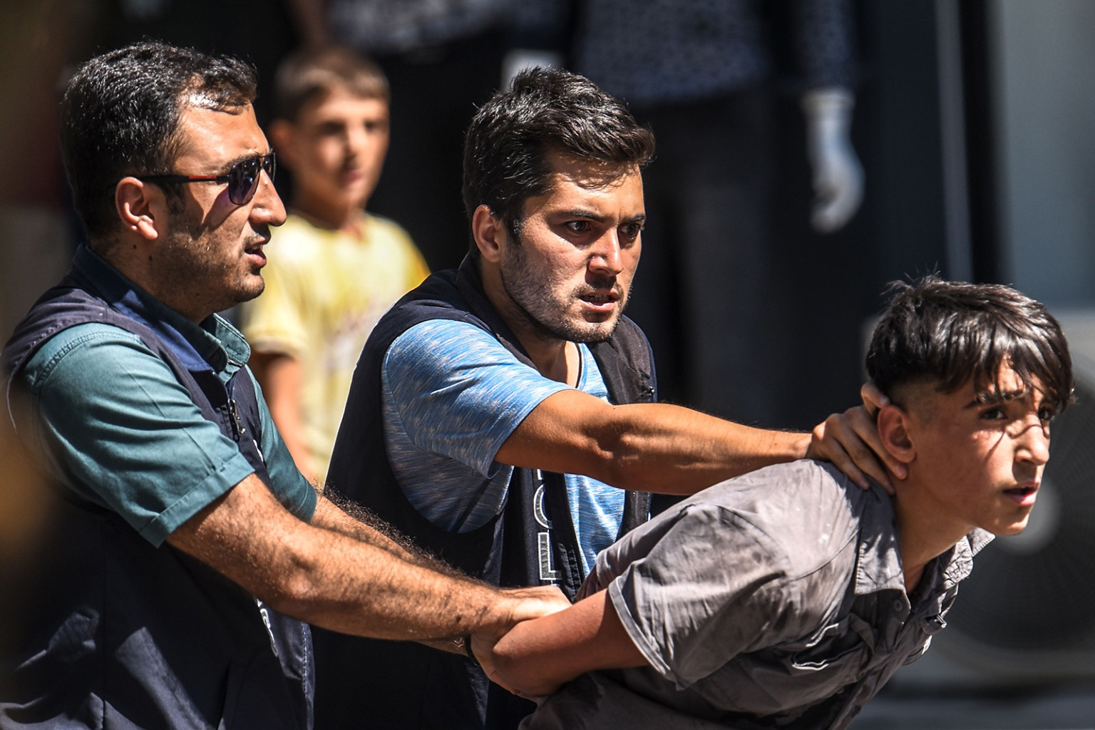 Turkish police officers detain a demonstrator during a protest against the replacement of Kurdish mayors with state officials in three cities, in Diyarbakir, eastern Turkey on Aug. 21. BULENT KILIC/AFP/Getty Images