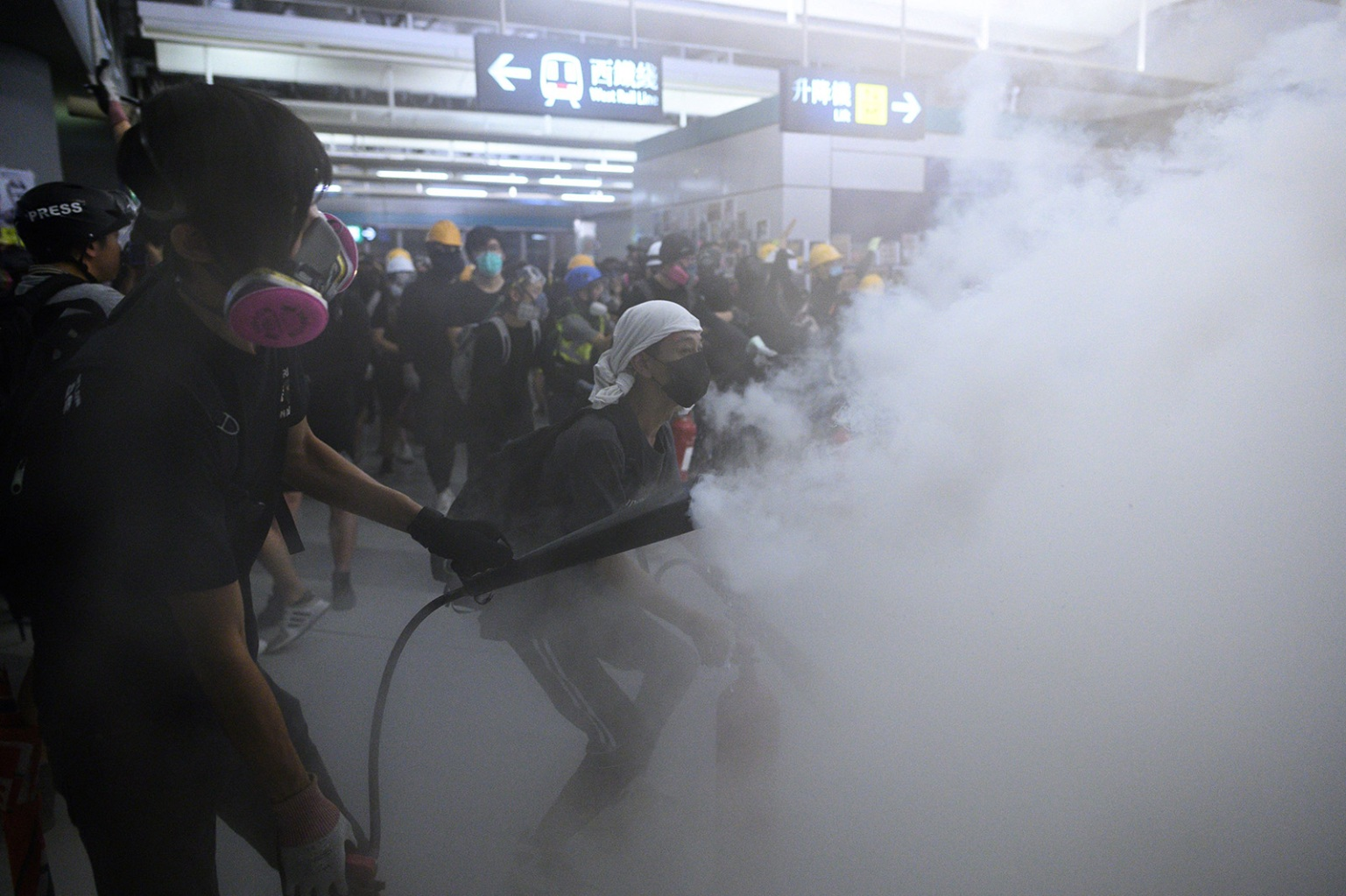 Protesters use fire extinguishers during a protest at the Yuen Long metro station in Hong Kong on Aug. 21. PHILIP FONG/AFP/Getty Images