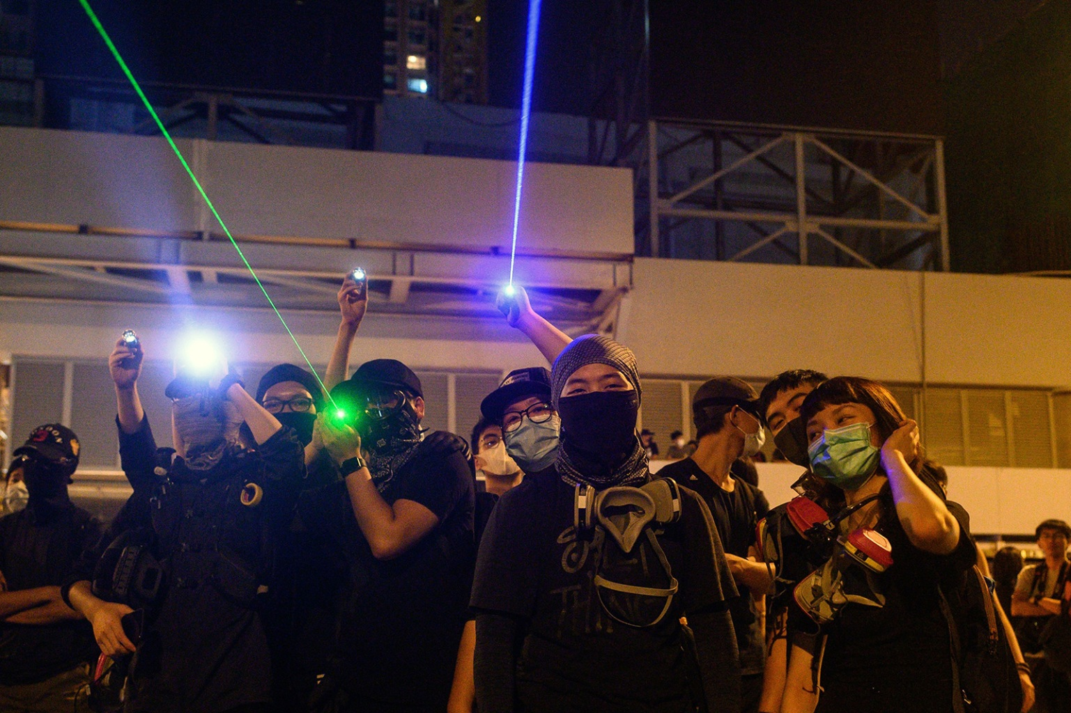 Protesters point laser beams toward the police outside the Yuen Long metro station during a protest in Hong Kong on Aug. 21. PHILIP FONG/AFP/Getty Images