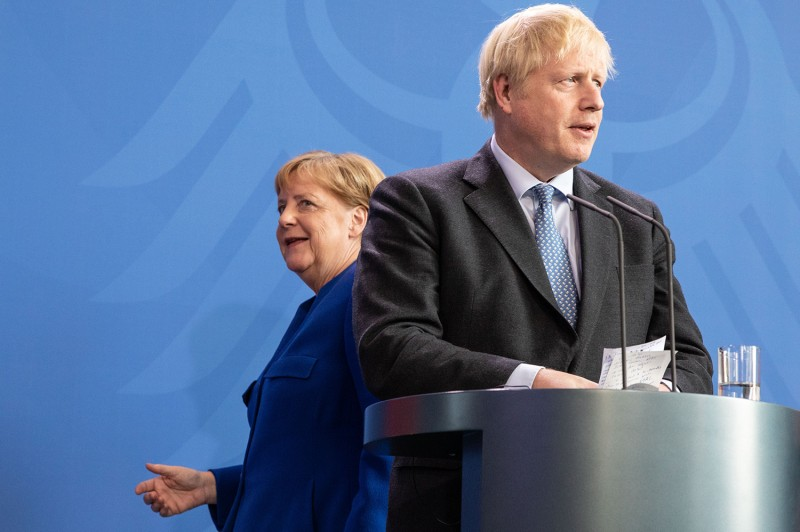British Prime Minister Boris Johnson and German Chancellor Angela Merkel attend a joint press conference following Johnson's arrival at the Chancellery on August 21 in Berlin.