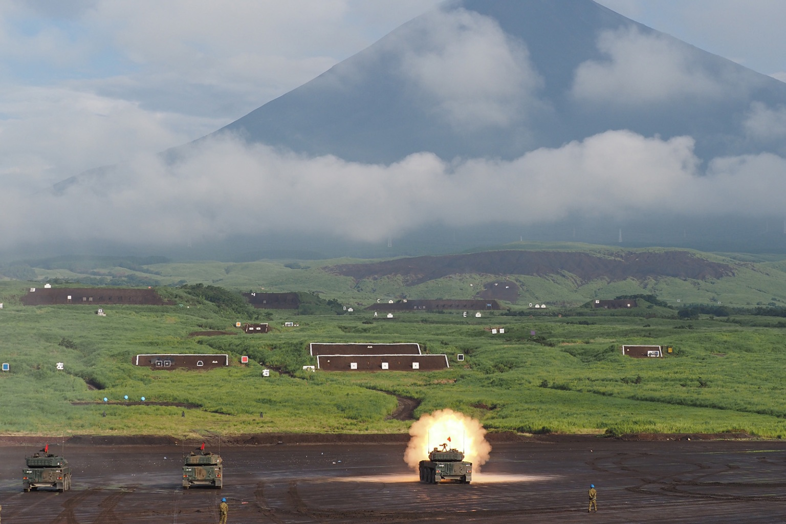 A Japan Ground Self Defense Forces tank fires during a training exercise at the foot of Mt. Fuji in Gotemba, Shizuoka prefecture, on Aug. 22. TOSHIFUMI KITAMURA/AFP/Getty Images