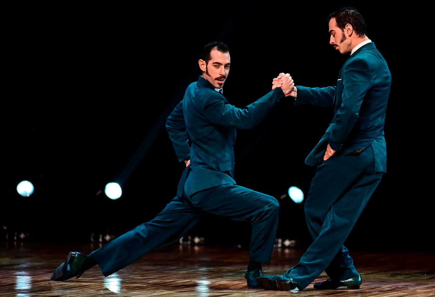 Argentinian twin dancers Nicolas Filipeli and German Filipeli perform at the Tango Dance World Championship in Buenos Aires on Aug. 21. RONALDO SCHEMIDT/AFP/Getty Images