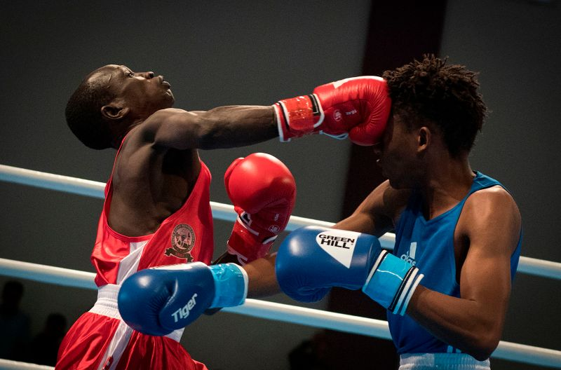 Lesotho's Mokhesi Tlholohelo, in blue, and South Sudan's Hal Hal compete during the men's light boxing competition in the African Games in Rabat, Morocco, on Aug. 21. FADEL SENNA/AFP/Getty Images