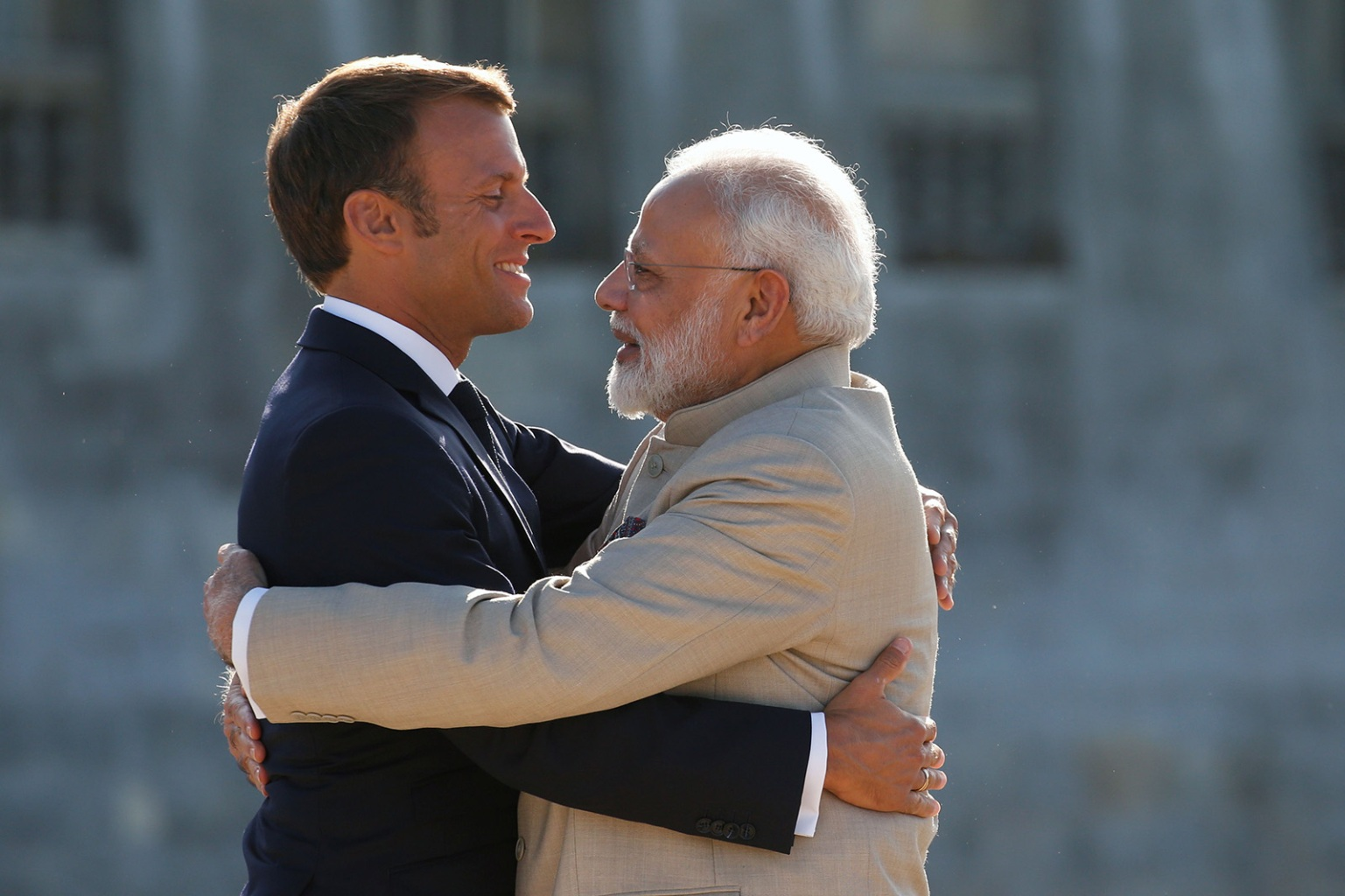 French President Emmanuel Macron hugs Indian Prime Minister Narendra Modi as he welcomes him before their meeting at the Chateau of Chantilly, near Paris, on Aug. 22. PASCAL ROSSIGNOL/AFP/Getty Images