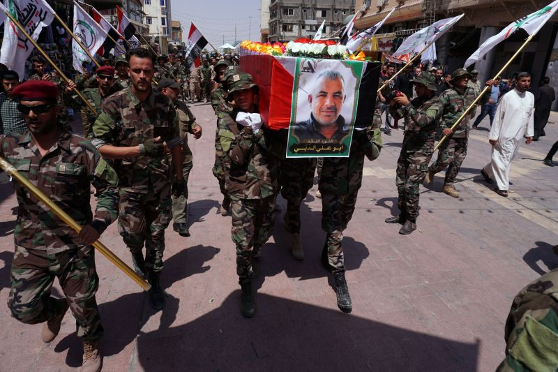 Members of Iraq's Popular Mobilization Forces carry the coffin of their comrade Kazem Mohsen, known by his nom de guerre Abu Ali al-Dabi, during his funeral procession in Najaf, Iraq, on Aug. 26.