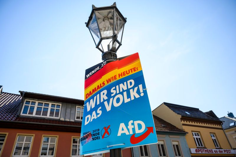 "An election campaign poster from the far-right Alernative fuer Deutschland (AfD) reads: ""We are the people!"" in Zehdenick in the federal state of Brandenburg, eastern Germany, on August 28, 2019, ahead of state elections."