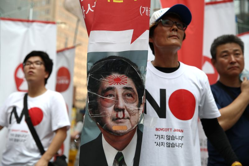 South Korean protesters participate in a rally to denounce Japan's new trade restrictions on South Korea in front of the Japanese embassy on August 03, 2019 in Seoul, South Korea.