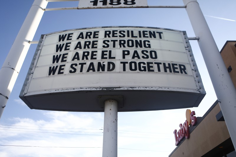 A sign is posted near the scene of a mass shooting that left at least 20 people dead on August 4 in El Paso, Texas.