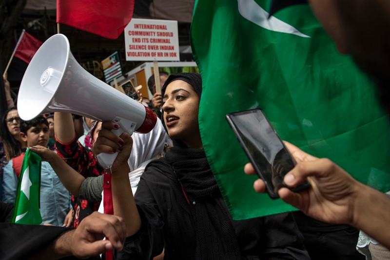 A pro-Kashmir demonstrator holds a megaphone outside India's diplomatic mission on August 15 in London.