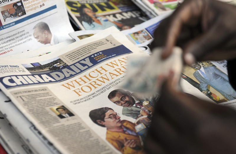 A customer pays for a copy of the Africa edition of China Daily at a newsstand in Nairobi on Dec. 14, 2012.