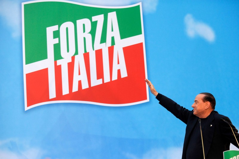 Former Italian Prime Minister Silvio Berlusconi gestures as he attends a rally in Rome on Nov. 27, 2013.