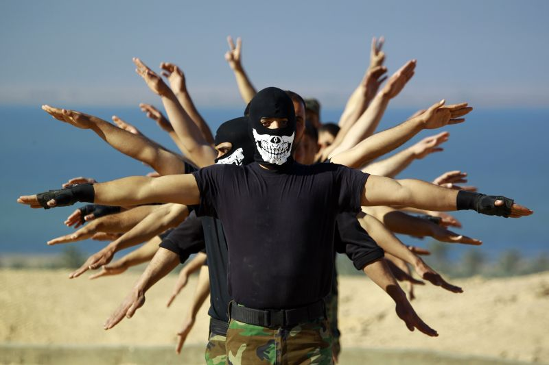 Fighters from the Iraqi Imam Ali Brigade, take part in a training exercise in Iraq's central city of Najaf on March 7, 2015, ahead of joining the military operation in the city of Tikrit.