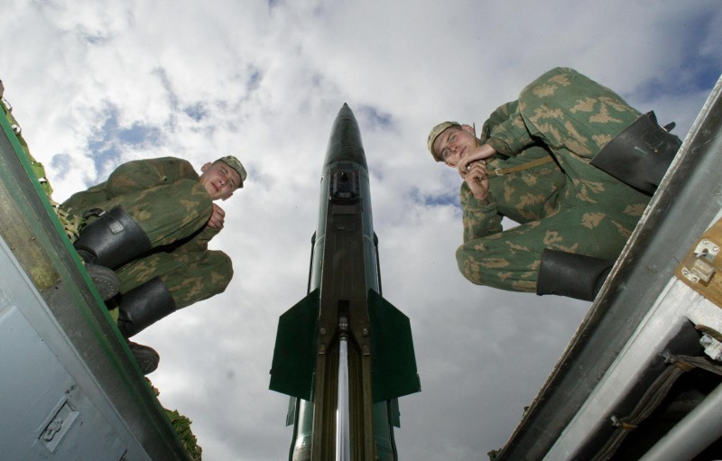 Russian soldiers sit on the launcher of a Tochka-M (Point-M) short-range missile at the military training ground outside of the Russian exclave of Kaliningrad on Oct. 5, 2005.