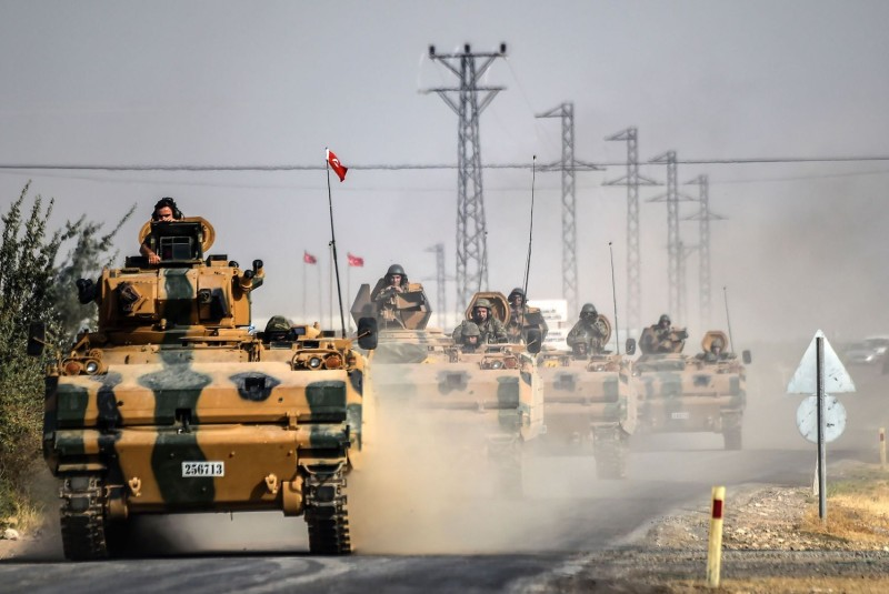 Turkish Army tanks driving to the Syrian-Turkish border town of Jarabulus on August 25, 2016.