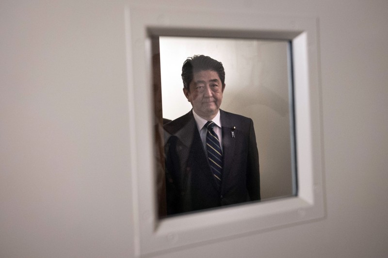 Japanese Prime Minister Shinzo Abe arrives for a bi-lateral meeting with British Prime Minister Theresa May at the United Nations Headquarters on September 20, 2016 in New York City.