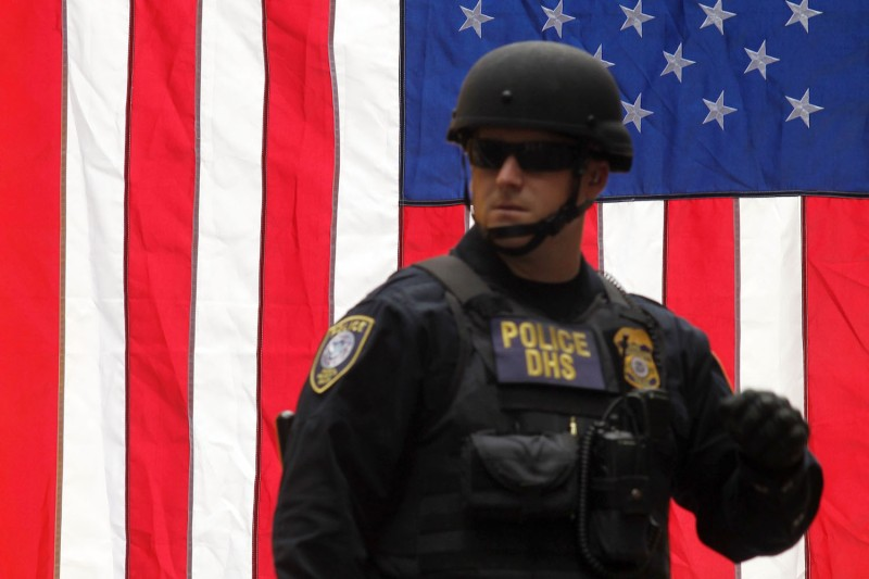 A U.S. Department of Homeland Security police officer in front of an American flag in Portland, Oregon, on June 4, 2017.