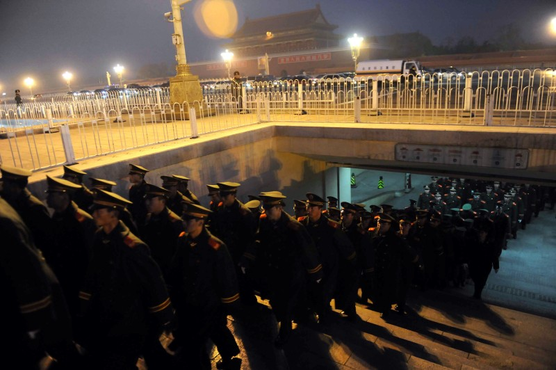 A detachment of the Chinese People's Armed Police responsible for the security of Tiananmen Square and the Forbidden City marches on to the square in Beijing on November 23, 2009.
