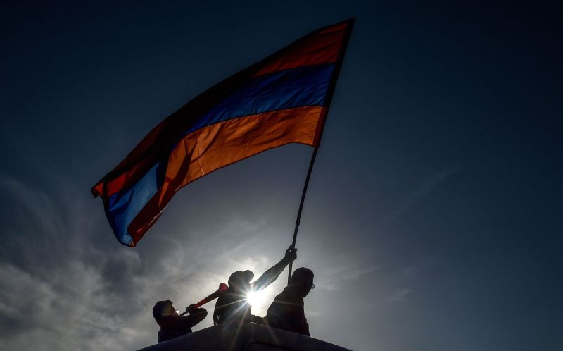 Protesters wave an Armenian national flag in Yerevan on May 2, 2018.