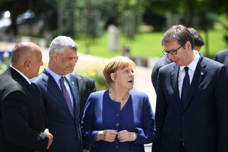 German Chancellor Angela Merkel speaks with Bulgarian Prime Minister Boyko Borisov, Serbian President Aleksandar Vucic, and Kosovar President Hashim Thaci during a summit on the Balkans in Sofia, Bulgaria, on May 17, 2018.