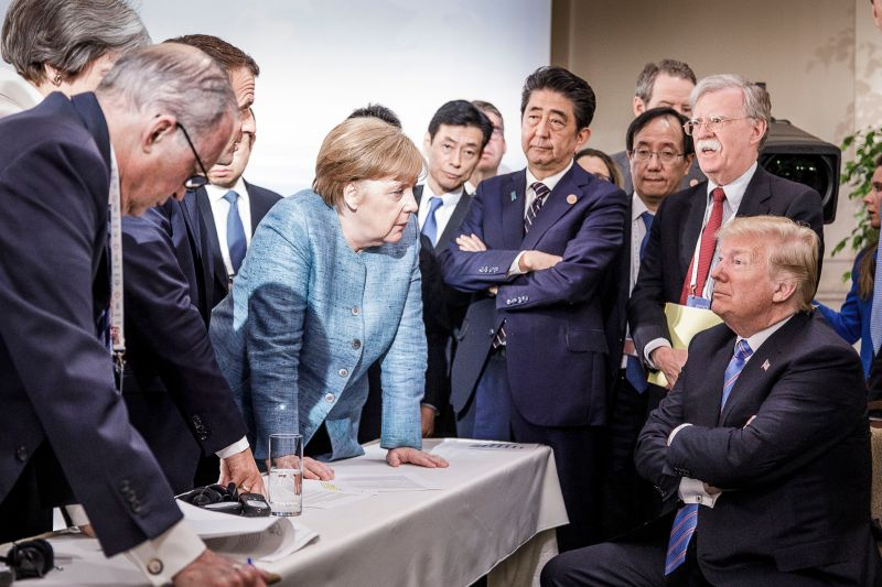 German Chancellor Angela Merkel deliberates with U.S. President Donald Trump at the G-7 summit in Charlevoix, Canada, on June 9, 2018.