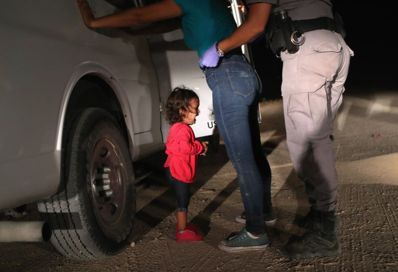 A 2-year-old Honduran asylum-seeker cries as her mother is searched and detained near the U.S.-Mexico border in McAllen, Texas, on June 12.