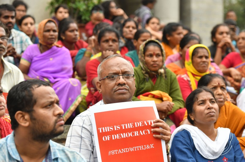 Protestors and activists belonging to the Alternative Law Forum and other left wing organizations take part in a protest in Bangalore on August 5, 2019, in reaction to the Indian government scrapping Article 370 that granted a special status to Jammu and Kashmir. (MANJUNATH KIRAN/AFP/Getty Images)