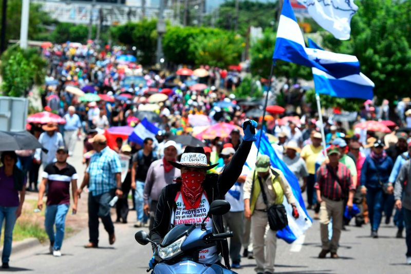 Demonstrators demand the resignation of Honduran President Juan Orlando Hernández, in Tegucigalpa, Honduras, on Aug. 7