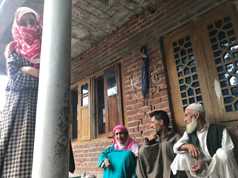 Family members of Seher, a 19-year-old they say was arrested during the crackdown, in their Karimabad house in Pulwama, Jammu and Kashmir, on Aug. 14.
