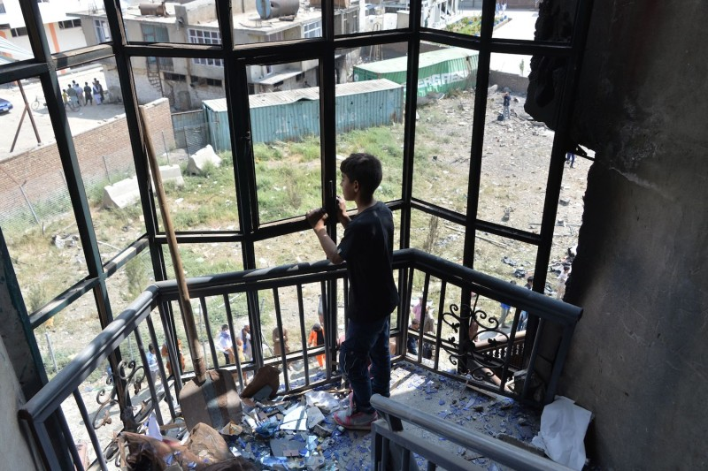 An Afghan boy looks on in a damaged house near the site of an attack in Kabul on July 29, a day after the deadly assault targeting a political campaign office.