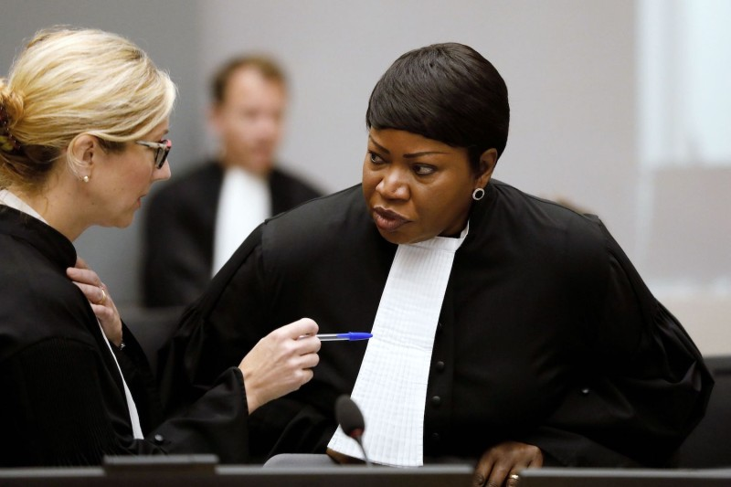 International Criminal Court Chief Prosecutor Fatou Bensouda (R) speaks with a colleague during the closing statements of the trial of former Congolese warlord Bosco Ntaganda in The Hague on Aug. 28, 2018.
