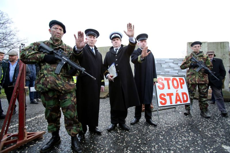Members of the anti-Brexit campaign group Border Communities Against Brexit, dressed up as British Army Soldiers and Customs officials, pose with a wall installed on a road crossing the border between Northern Ireland and Ireland, during a demonstration in Newry, Northern Ireland, on Jan. 26.