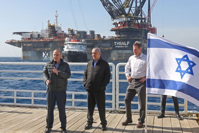 Israel's Energy Minister Yuval Steinitz (L) speaks as Prime Minister Benjamin Netanyahu (C) and Noble Energy's Vice President for Major Projects George Hatfield (R) stand by during the inauguration of the newly-arrived foundation platform for the Leviathan natural gas field in the Mediterranean Sea, about 80 miles west of the Israeli city of Haifa, on January 31.