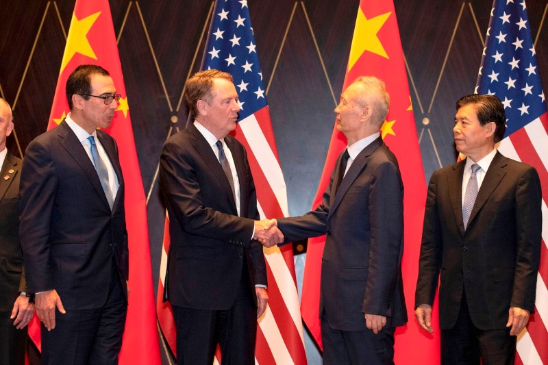 United States Trade Representative Robert Lighthizer (center-left) shakes hands with China's Vice Premier Liu He (center-right) as U.S. Treasury Secretary Steven Mnuchin (L) and China's Commerce Minister Zhong Shan (R) look on at the Xijiao Conference Center in Shanghai on July 31.
