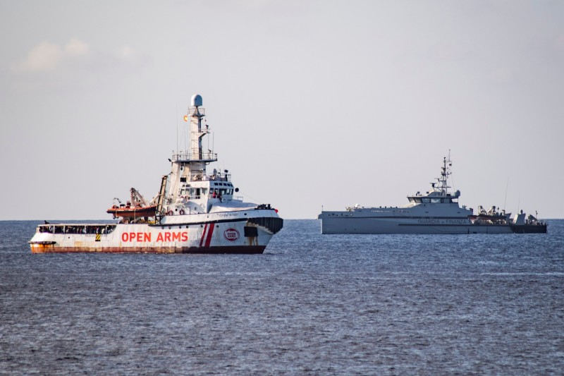 An Italian Guardia di Finanza ship sails towards the Spanish migrant rescue NGO ship Open Arms to retrieve 27 unaccompanied minors and take them to the Italian island of Lampedusa on August 17, 2019.