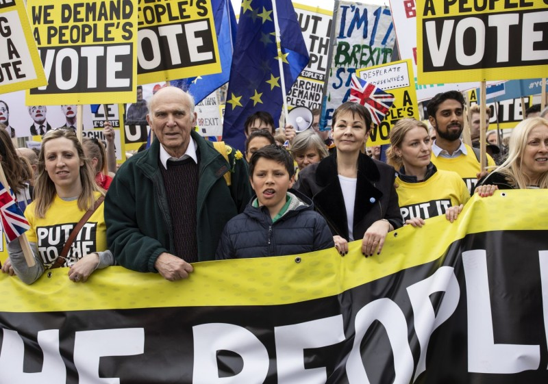 Protesters including Leader of the Liberal Democrats Sir Vince Cable  and the Green Party's Caroline Lucas take part in the Put It To The People March on Whitehall on March 23 in London.